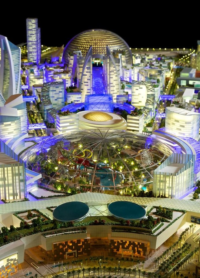 Photo - This image provided by Dubai Holding on Saturday July 5, 2014, shows an artist rendition of their planned Mall of the World project that will include an 8 million square foot (743,224 square meter) mall, a climate-controlled street network, a theme park covered during the scorching summer months and 100 hotels and serviced apartments. Dubai Holding, a conglomerate controlled by the emirate's ruler, is developing the complex. It gave no details on the cost or the completion date. (AP Photo/Dubai Holding)