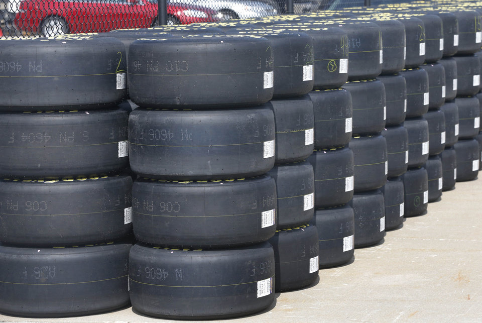 Photo - Goodyear racing tires await distribution to NASCAR teams at Kansas Speedway in Kansas City, Kan., Thursday, Oct. 3, 2013. Teams are testing tires on the recently re-surfaced track. (AP Photo/Orlin Wagner)