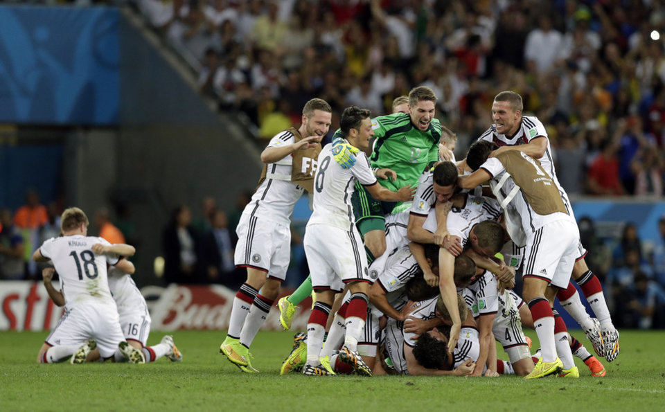 Photo - Germany players celebrate after the World Cup final soccer match between Germany and Argentina at the Maracana Stadium in Rio de Janeiro, Brazil, Sunday, July 13, 2014. Germany beat Argentina 1-0 to win its fourth World Cup title. (AP Photo/Victor R. Caivano)