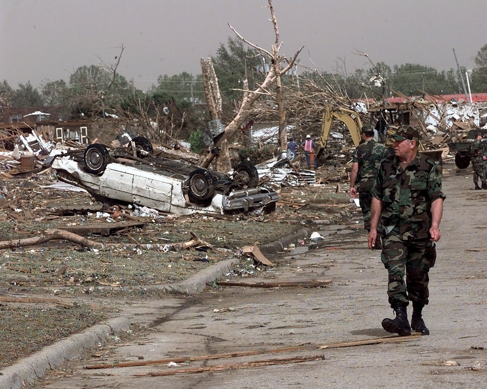 MAY 3, 1999 TORNADO: Memebers of the National Guard survey the tornado damage on 43rd street just west of Sooner in Del City.