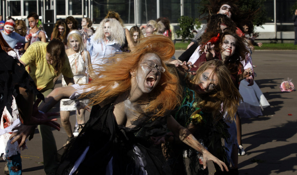 """Photo - Michael Jackson fans dressed as zombies dance to the song """"Thriller""""  in Moscow, Russia, Saturday, Aug. 29, 2009, marking the the late King of Pop's birthday anniversary. (AP Photo/Sergey Ponomarev) ORG XMIT: XSP102"""