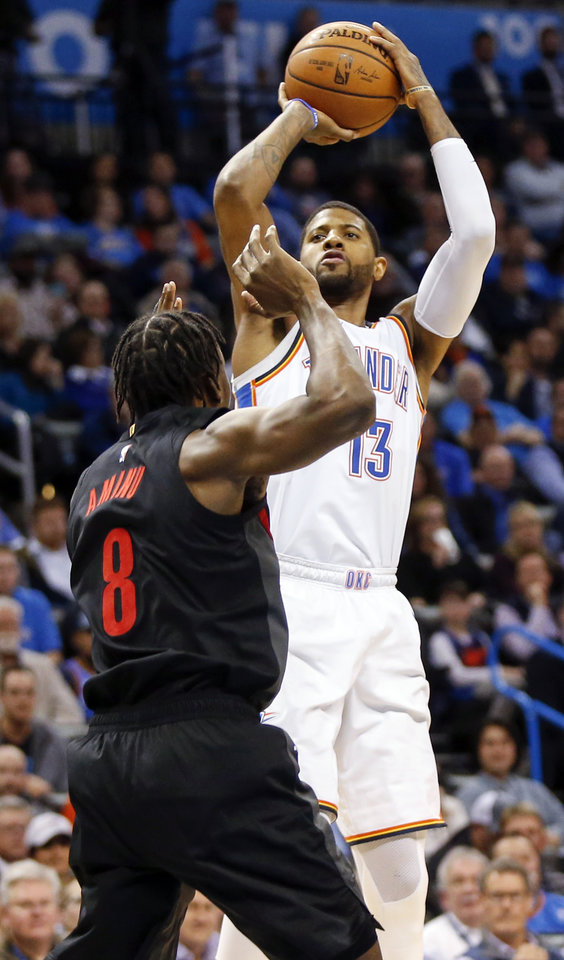 Photo - Oklahoma City's Paul George (13) shoots over Portland's Al-Farouq Aminu (8) in the third quarter during an NBA basketball game between the Portland Trail Blazers and the Oklahoma City Thunder at Chesapeake Energy Arena in Oklahoma City, Monday, Feb. 11, 2019. Oklahoma City won 120-111. Photo by Nate Billings, The Oklahoman