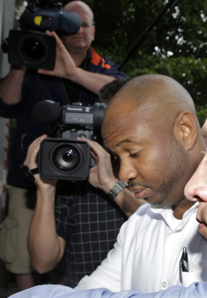 Photo - Kevin Roper, walks past cameras blocking him as he arrives for a court appearance Wednesday, June 11, 2014, in New Brunswick, N.J. Roper, a Wal-Mart truck driver from Georgia, was charged with death by auto and four counts of assault by auto in the wake of a deadly chain-reaction crash on the New Jersey Turnpike early Saturday, June 7, 2014, that killed comedian James McNair and left actor-comedian Tracy Morgan and two others critically injured.  (AP Photo/Mel Evans)