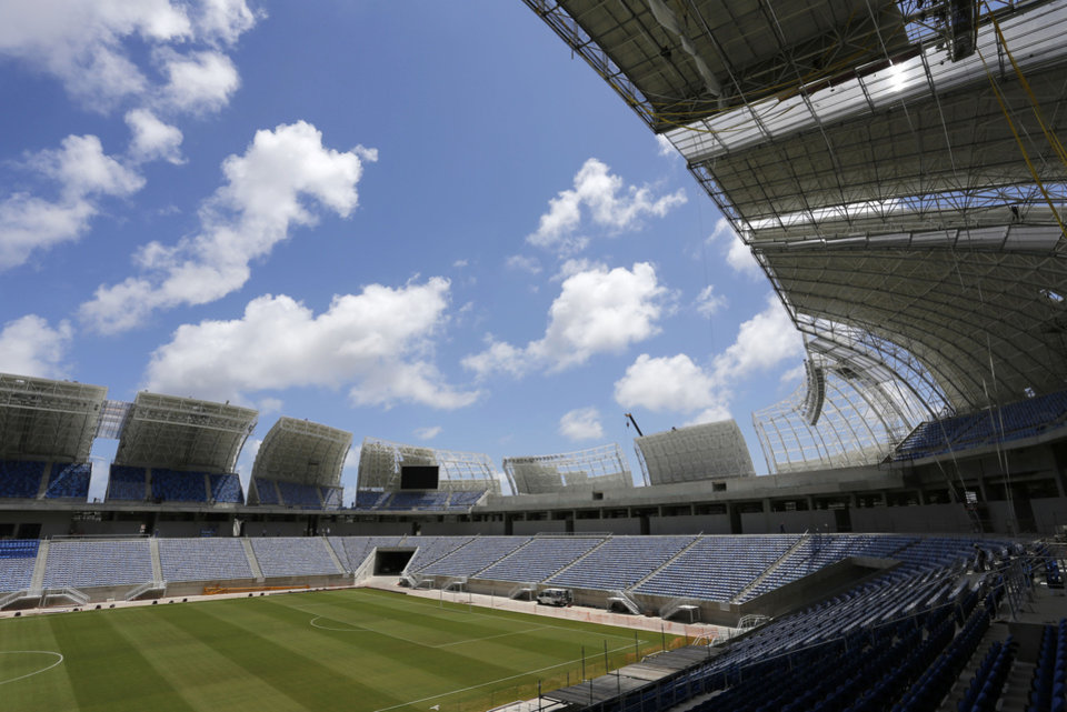 FILE - This Dec. 13, 2013 file photo shows the Estadio das Dunas in Natal, Brazil. Four matches of the 2014 soccer World Cup will be played in the stadium. (AP Photo/Ferdinand Ostrop, File)