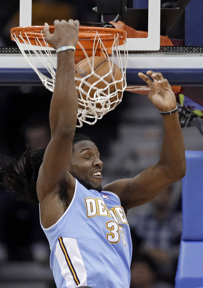 Photo - Denver Nuggets' Kenneth Faried dunks against the Cleveland Cavaliers in the second quarter of an NBA basketball game Saturday, Feb. 9, 2013, in Cleveland. (AP Photo/Mark Duncan)