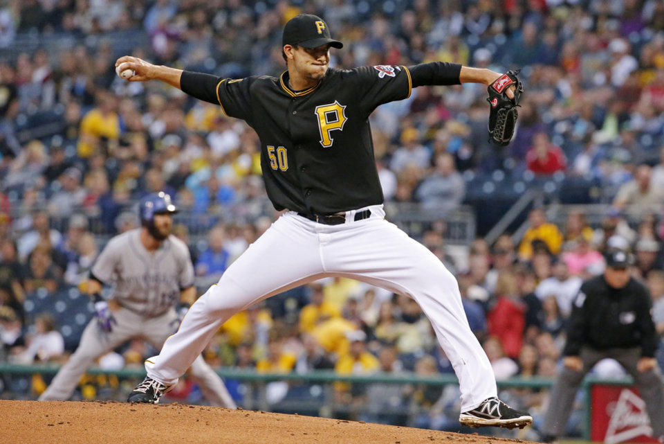 Photo - Pittsburgh Pirates starting pitcher Charlie Morton delivers during the first inning of a baseball game against the Colorado Rockies in Pittsburgh Saturday, July 19, 2014. (AP Photo/Gene J. Puskar)