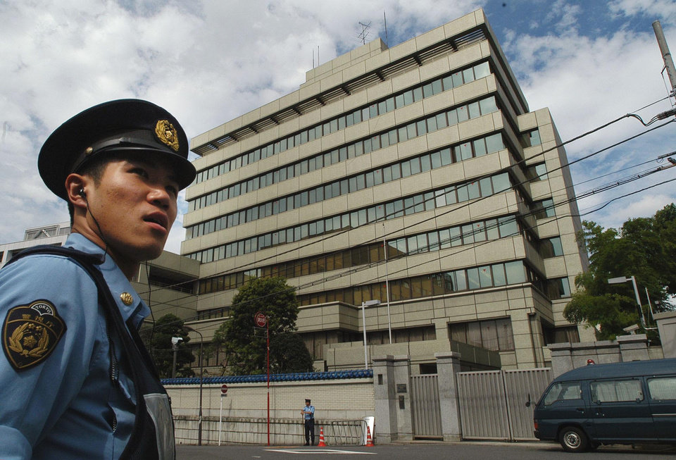 Photo - FILE - In this Wednesday, Sept. 10, 2003 file photo, a Japanese police officer is on patrol in front of the headquarters of the pro-Pyongyang General Association for Korean Residents in Japan, in Tokyo. Japan approved easing its sanctions on North Korea on Friday in response to Pyongyang's reopening of a probe into the fate of at least a dozen Japanese allegedly abducted to the North decades ago. Officials of Chongryong, or the General Association of Korean Residents in Japan, which serves as a de-facto North Korean embassy here, can obtain re-entry permits after traveling to North Korea. (AP Photo/Katsumi Kasahara, File)