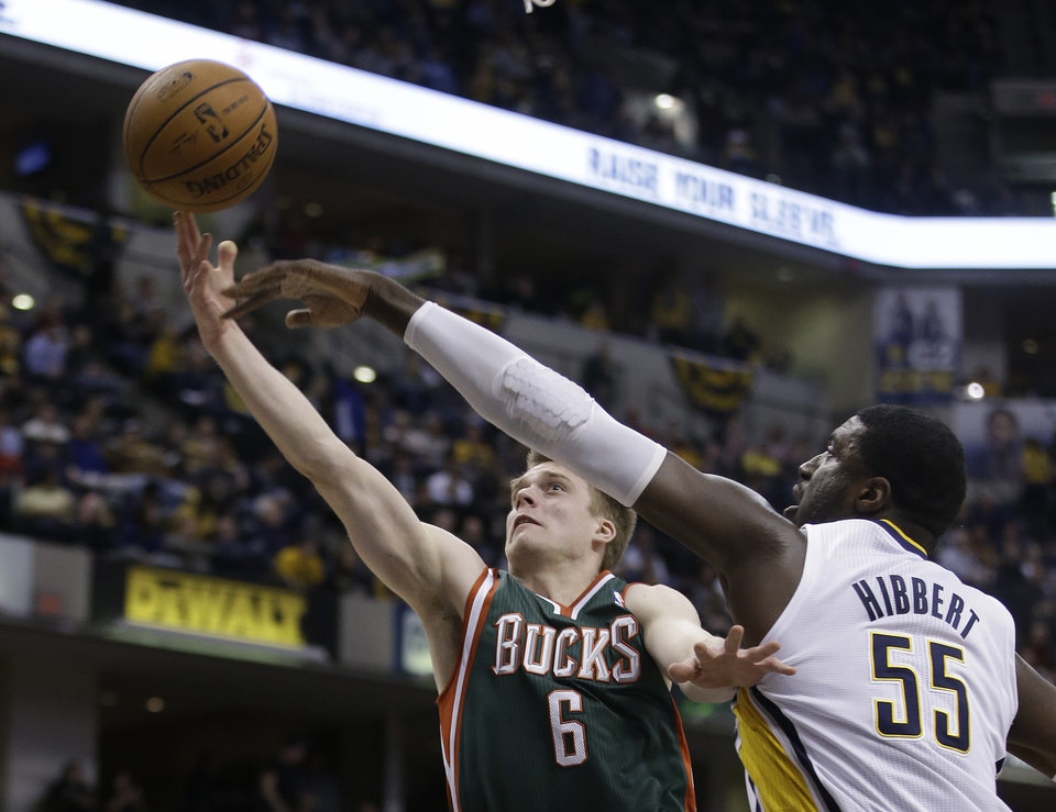 Photo - Milwaukee Bucks' Nate Wolters (6) shoots against Indiana Pacers' Roy Hibbert (55) during the first half of an NBA basketball game on Thursday, Feb. 27, 2014, in Indianapolis. (AP Photo/Darron Cummings)