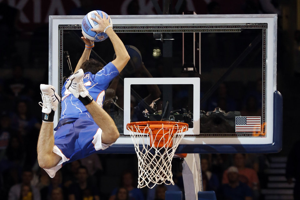 Photo - Thunder entertainment demonstrates their ability to dunk aided by a trampoline as the Oklahoma City Thunder play the Atlanta Hawks in NBA basketball at the Chesapeake Energy Arena in Oklahoma City, on Sunday, Nov. 4, 2012.  Photo by Steve Sisney, The Oklahoman