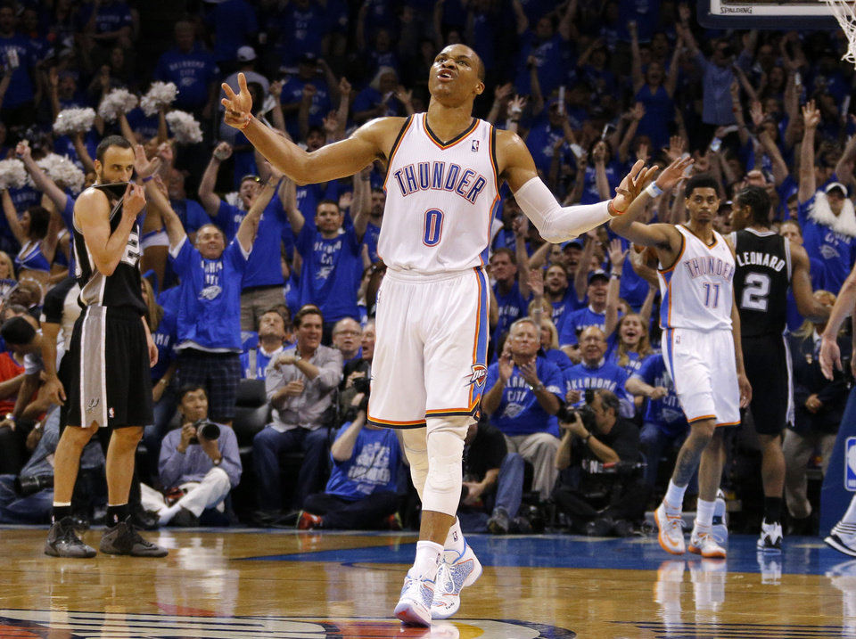 Photo - Oklahoma City's Russell Westbrook (0) celebrates during Game 3 of the Western Conference Finals in the NBA playoffs between the Oklahoma City Thunder and the San Antonio Spurs at Chesapeake Energy Arena in Oklahoma City, Sunday, May 25, 2014. Photo by Bryan Terry, The Oklahoman