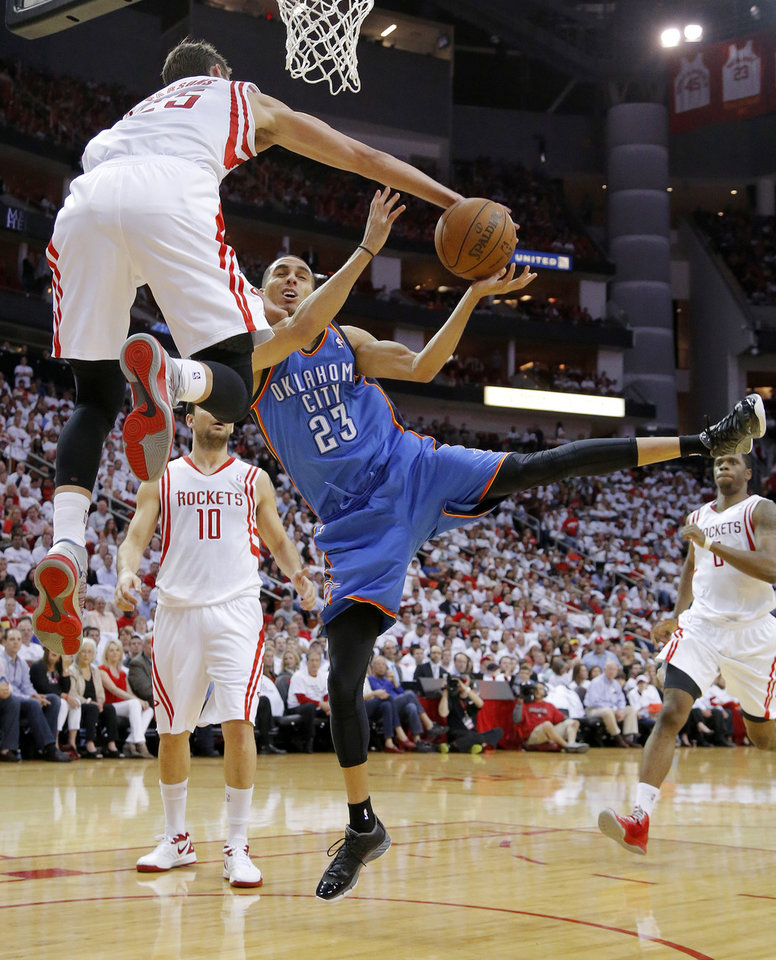 Oklahoma City\'s Kevin Martin (23) is fouled by Houston\'s Chandler Parsons (25) during Game 3 in the first round of the NBA playoffs between the Oklahoma City Thunder and the Houston Rockets at the Toyota Center in Houston, Texas, Sat., April 27, 2013. Photo by Bryan Terry, The Oklahoman