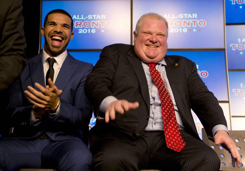 Photo - Canadian recording artist Drake, left, and Toronto Mayor Rob Ford laugh at a news conference announcing that Toronto will host the 2016 NBA All-Star game, in Toronto, Monday, Sept. 30, 2013. (AP Photo/The Canadian Press, Frank Gunn)