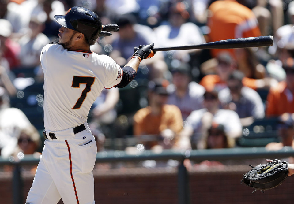 Photo - San Francisco Giants' Gregor Blanco drives in a run with a ground rule double against the Miami Marlins during the fifth inning of a baseball game on Saturday, June 22, 2013, in San Francisco. (AP Photo/Marcio Jose Sanchez)
