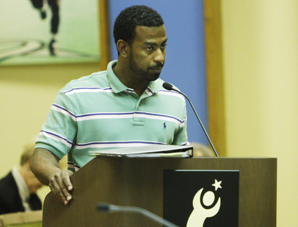 Photo - Derek Brown, a 2nd grade teacher for ten years at Marcus Garvey Leadership Academy, addresses the Oklahoma City School Board on May 28, 2013.  Photo by KT King, The Oklahoman
