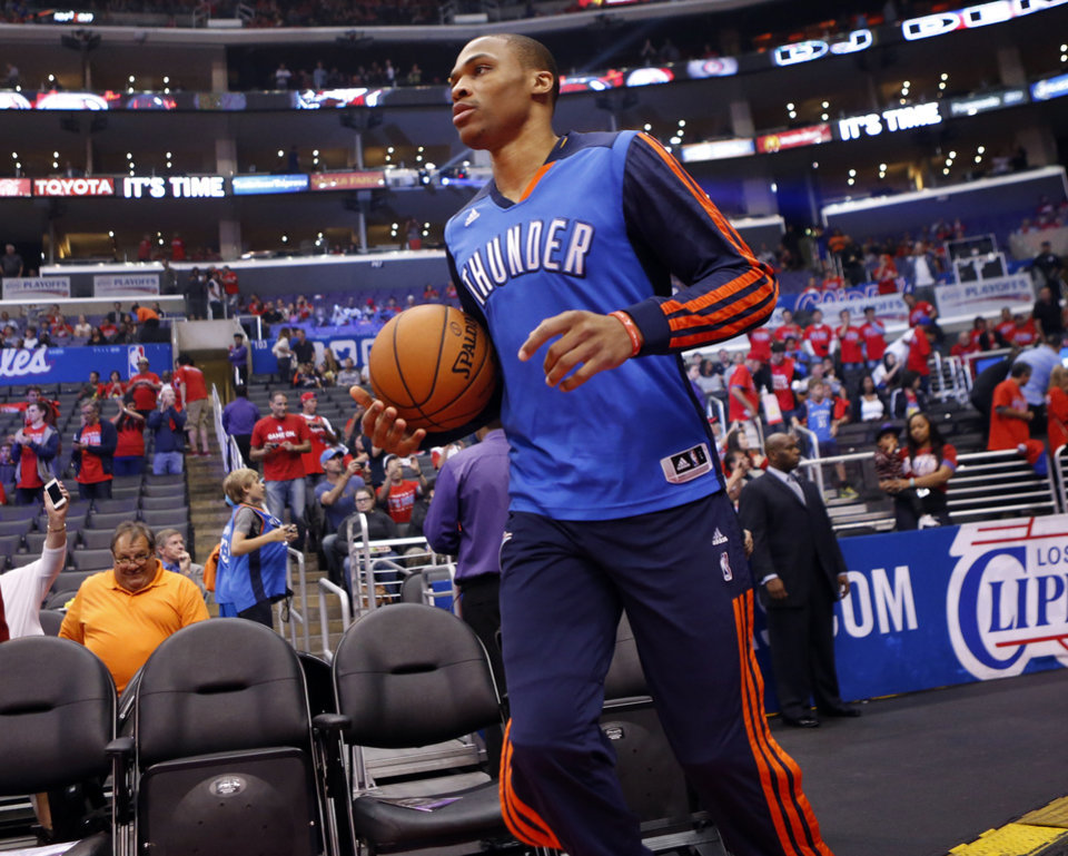 Photo - Oklahoma City's Russell Westbrook (0) walks on to the court for warm ups during Game 3 of the Western Conference semifinals in the NBA playoffs between the Oklahoma City Thunder and the Los Angeles Clippers at the Staples Center in Los Angeles, Friday, May 9, 2014. Photo by Nate Billings, The Oklahoman