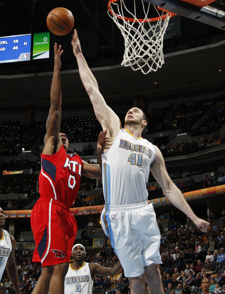 Denver Nuggets center Kosta Koufos, right, goes up to block a shot by Atlanta Hawks guard jeff Teague in the first quarter of an NBA basketball game in Denver on Monday, March 4, 2013. (AP Photo/David Zalubowski)