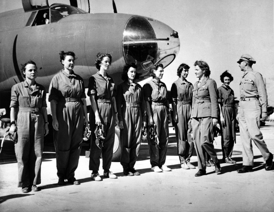 FILE - This Sept. 22, 1942 black-and-white file photo shows Aviatrix Nancy Harkness Love, director of the Women's Auxiliary Ferry Squadron (WAFS), and Col. Robert H. Baker, commanding officer, inspect the first contingent of women pilots in the WAFS at the New Castle Army Air Base, Del. Women served and died on the nation�s battlefields from the first. They were nurses and cooks, spies and couriers in the Revolutionary War. Some disguised themselves as men to fight for the Union or the Confederacy. Yet the U.S. military�s official acceptance of women in combat took more than two centuries. New roles for females were doled out fitfully _ whenever commanders got in a bind and realized they needed women�s help. A look at milestones on the way to lifting the ban on women in ground combat.  (AP Photo, File)
