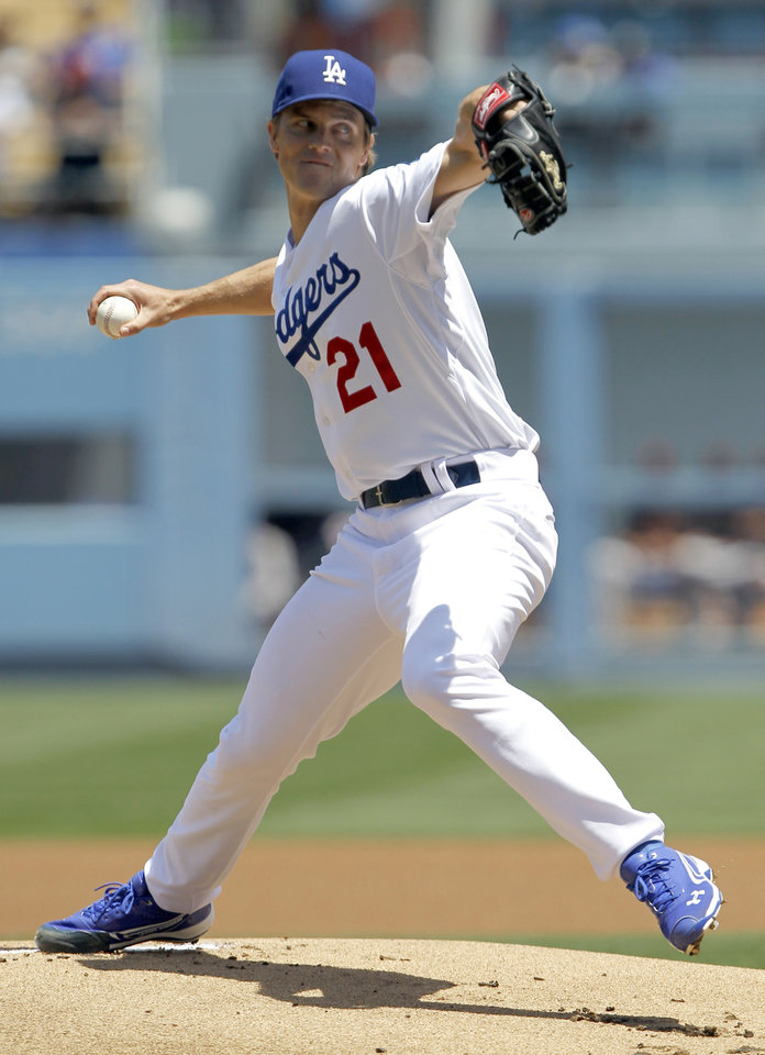Photo - Los Angeles Dodgers starting pitcher Zack Greinke throws against the San Francisco Giants in the first inning of a baseball game on Saturday, May 10, 2014, in Los Angeles. (AP Photo/Alex Gallardo)