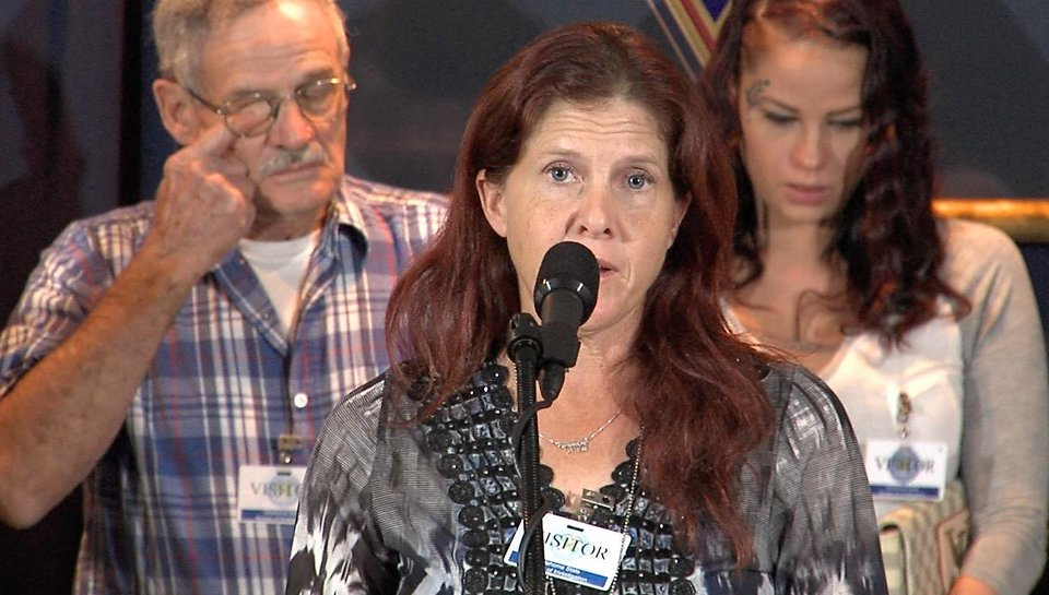 Photo -  Margie Queen, mother of Carina Saunders, addresses the media at the Oklahoma State Bureau of Investigation headquarters on the eve of the five-year anniversary of her daughter's body being found outside a Bethany grocery store. [Photo by Tim Money, The Oklahoman]