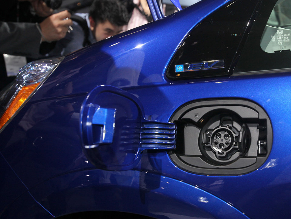 Photo - The charging port on the new all-electric 2013 Honda Fit EV is seen Nov. 16 during its debut at the Los Angeles Auto Show. AP Photo