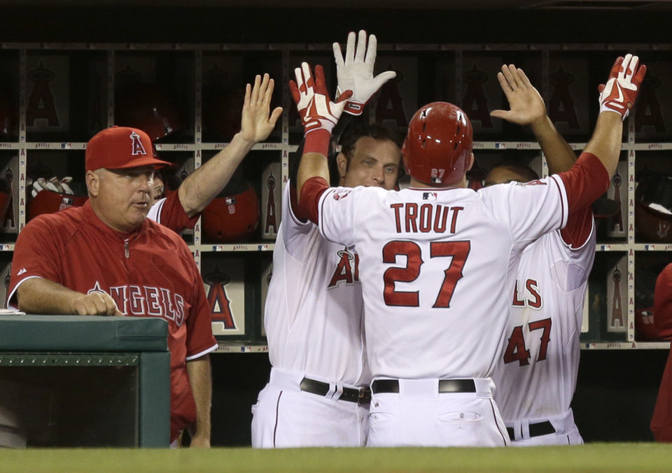 Photo - Los Angeles Angels' Mike Trout celebrates his home run against the Kansas City Royals during the eighth inning of a baseball game in Anaheim, Calif., Wednesday, May 15, 2013. (AP Photo/Chris Carlson)