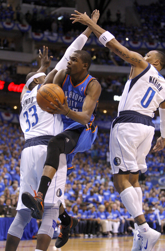 Oklahoma City\'s Kevin Durant (35) goes to the basket between Dallas\' Brendan Haywood (33) and Shawn Marion (0) during Game 3 of the first round in the NBA playoffs between the Oklahoma City Thunder and the Dallas Mavericks at American Airlines Center in Dallas, Thursday, May 3, 2012. Photo by Bryan Terry, The Oklahoman