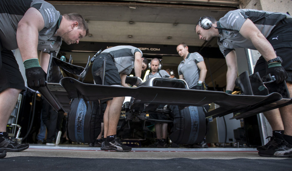 Photo - Mechanics slip on the nose cone on the car of Mercedes driver Lewis Hamilton from Great Britain during the third practice session at the Canadian Grand Prix Saturday, June 7, 2014 in Montreal. (AP Photo/The Canadian Press, Paul Chiasson)