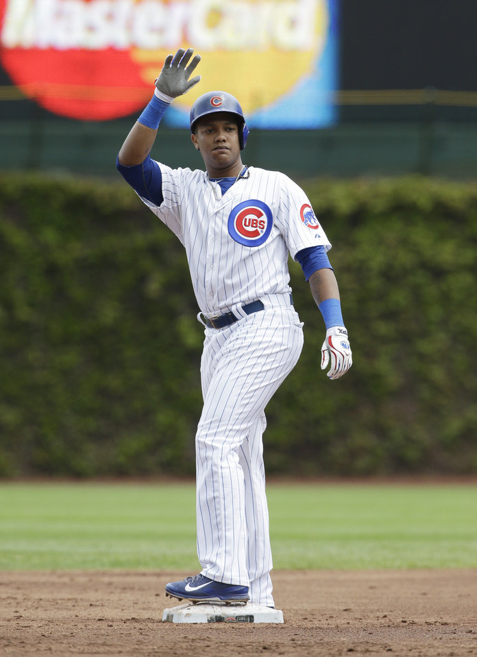 Photo - Chicago Cubs' Starlin Castro waves to the dugout after hit an one-run double during the first inning of a baseball game against the Milwaukee Brewers in Chicago, Saturday, May 17, 2014. (AP Photo/Nam Y. Huh)