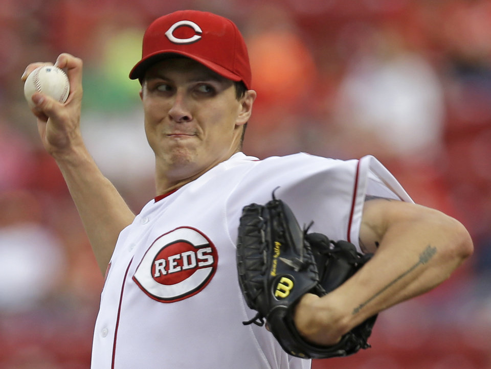 Photo - Cincinnati Reds starting pitcher Homer Bailey throws against the Arizona Diamondbacks in the first inning of a baseball game, Monday, July 28, 2014, in Cincinnati. (AP Photo/Al Behrman)