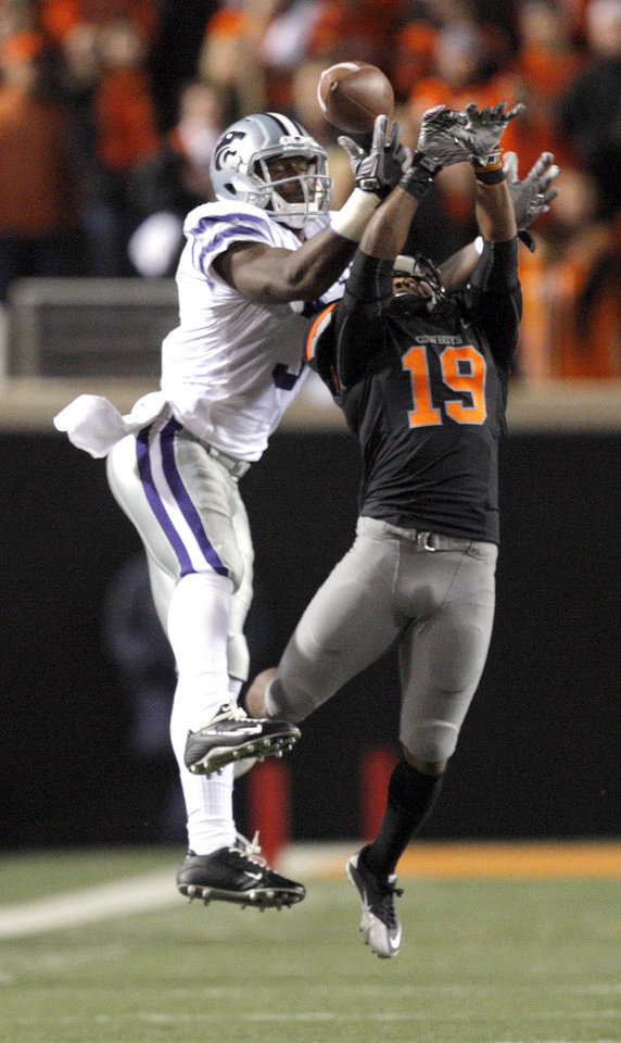 Photo - Oklahoma State's Brodrick Brown (19) tips a pass intended for Kansas State's Chris Harper (3) during a college football game between the Oklahoma State University Cowboys (OSU) and the Kansas State University Wildcats (KSU) at Boone Pickens Stadium in Stillwater, Okla., Saturday, Nov. 5, 2011.  Photo by Sarah Phipps, The Oklahoman