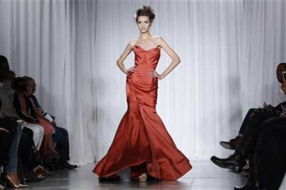 Photo -  Zac Posen spring 2014 collection shown on the runway in New York. AP PHOTO
