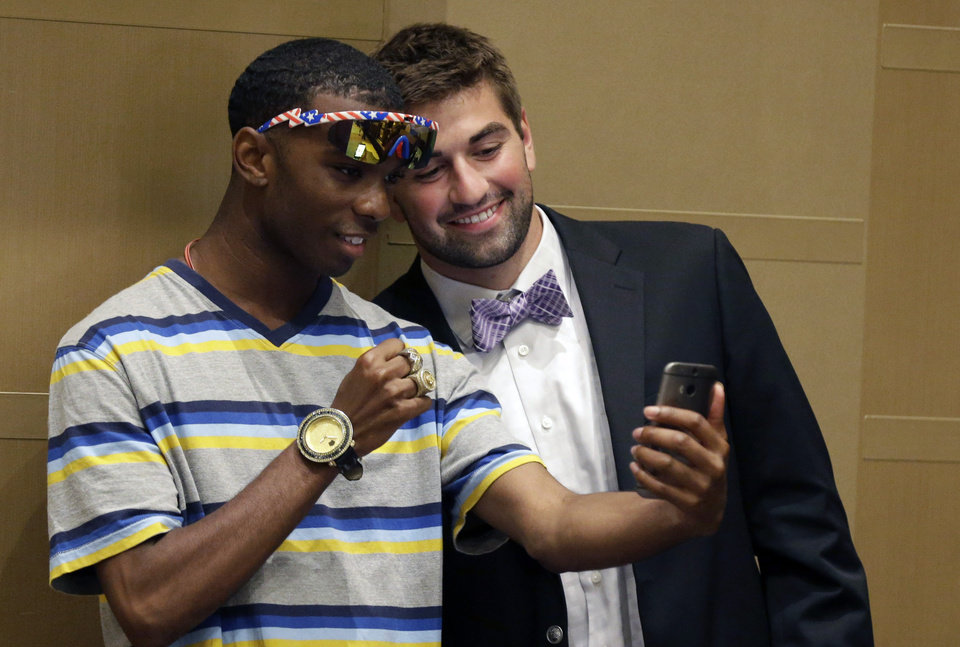 Photo - Kansas State quarterback Jack Waters, right, poses for a cell phone photo with Michael Scott, Jr., during the NCAA college Big 12 Conference football media days in Dallas, Tuesday, July 22, 2014. (AP Photo)