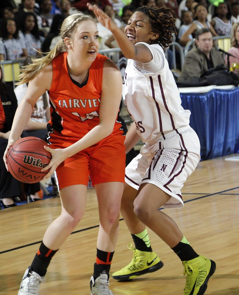 Photo - Northeast's Danielle Gaddis (11) defends on Fairview's Payton Van Meter (14) during the state high school basketball tournament Class 2A girls semifinal game between Fairview High School and Northeast High School at the State Fair Arena on Friday, March 8, 2013, in Oklahoma City, Okla. Photo by Chris Landsberger, The Oklahoman