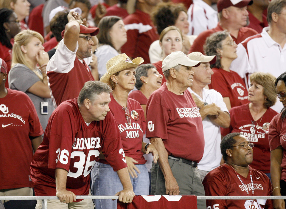 OU fans react after OU's 14-13 loss in the college football game between the Brigham Young University Cougars (BYU) and the University of Oklahoma Sooners (OU) at Cowboys Stadium in Arlington, Texas, Saturday, September 5, 2009. By Bryan Terry, The Oklahoman