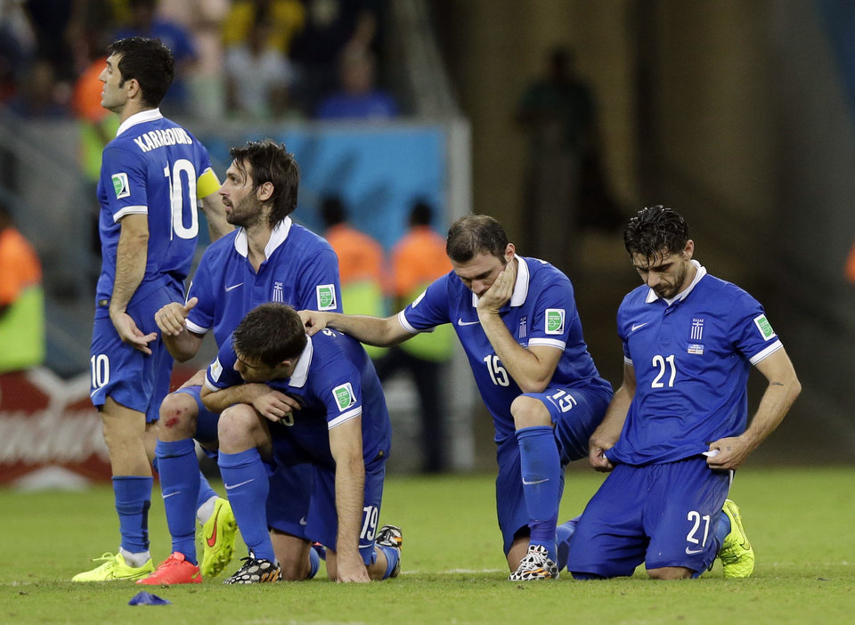 Photo - Greek players react during a penalty shootout at the end of the World Cup round of 16 soccer match between Costa Rica and Greece at the Arena Pernambuco in Recife, Brazil, Sunday, June 29, 2014. Costa Rica won 5-3 on penalties after the match ended 1-1. (AP Photo/Andrew Medichini)