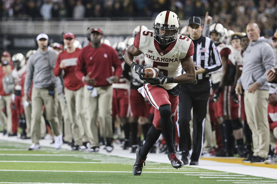 Photo - Oklahoma wide receiver A.D. Miller runs after the catch against Baylor during the second half of an NCAA college football game in Waco, Texas, Saturday, Nov. 16, 2019. Oklahoma won 34-31. (AP Photo/Ray Carlin)