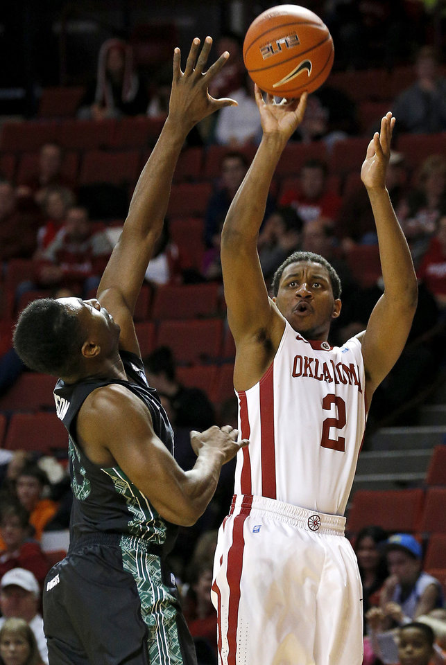 Photo - Oklahoma's Steven Pledger (2) shoots the ball over Ohio's Ricardo Johnson (20) during a NCAA college basketball game between the University of Oklahoma (OU) and Ohio at the Lloyd Noble Center in Norman, Saturday, Dec. 29, 2012. Oklahoma won 74-63. Photo by Bryan Terry, The Oklahoman