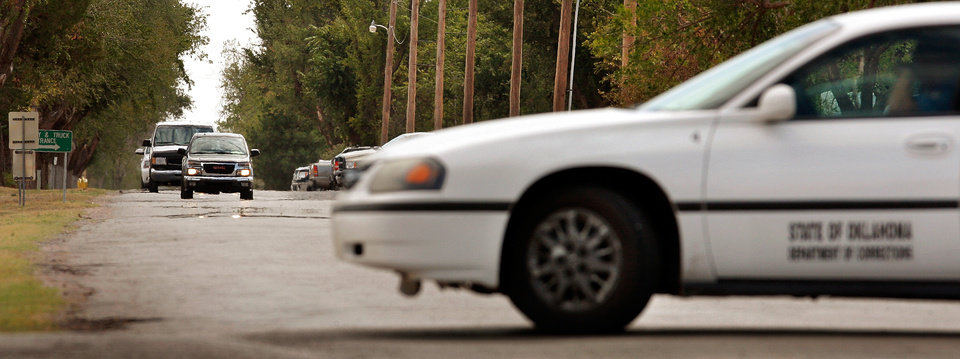 A caravan of vehicles led by Judge Richard Darby leaves prison grounds in Granite after a brief visit Wednesday morning.  While the jurors were there, access to the area was restricted and a Department of Corrections officer (in vehicle at right) was stationed at a nearby intersection to block traffic. Jury deliberations continue Wednesday, Sep. 21, 2011 in the trial of Bobbi Parker  in the Greer County Courthouse in Mangum ,  Okla.  Jurors were loaded into a church van and taken about about 10 miles to see the Oklahoma State Reformatory in Granite.  Jurors had asked to see the property around the warden's home there. Photo by Jim Beckel, The Oklahoman