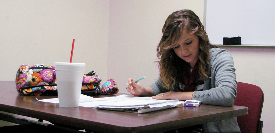 Photo - Sophomore Kayla Cernosek studies for her final  exams in the Mabee Learning Center at Oklahoma Baptist University in Shawnee. The school of about 2,000 students has finals until Thursday, with  winter commencement on Friday.  Photo by Vallery Brown, The Oklahoman