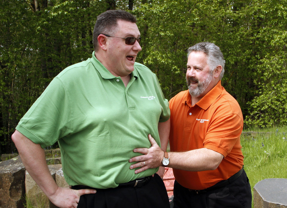 Photo -   Washougal Mayor Sean Guard, right, feels the stomach of Camas Mayor Scott Higgins before their weigh-in in Washougal, Wash., Wednesday, May 2, 2012. The mayors of the two neighboring Washington state towns on the banks of the Columbia River are embarking on a