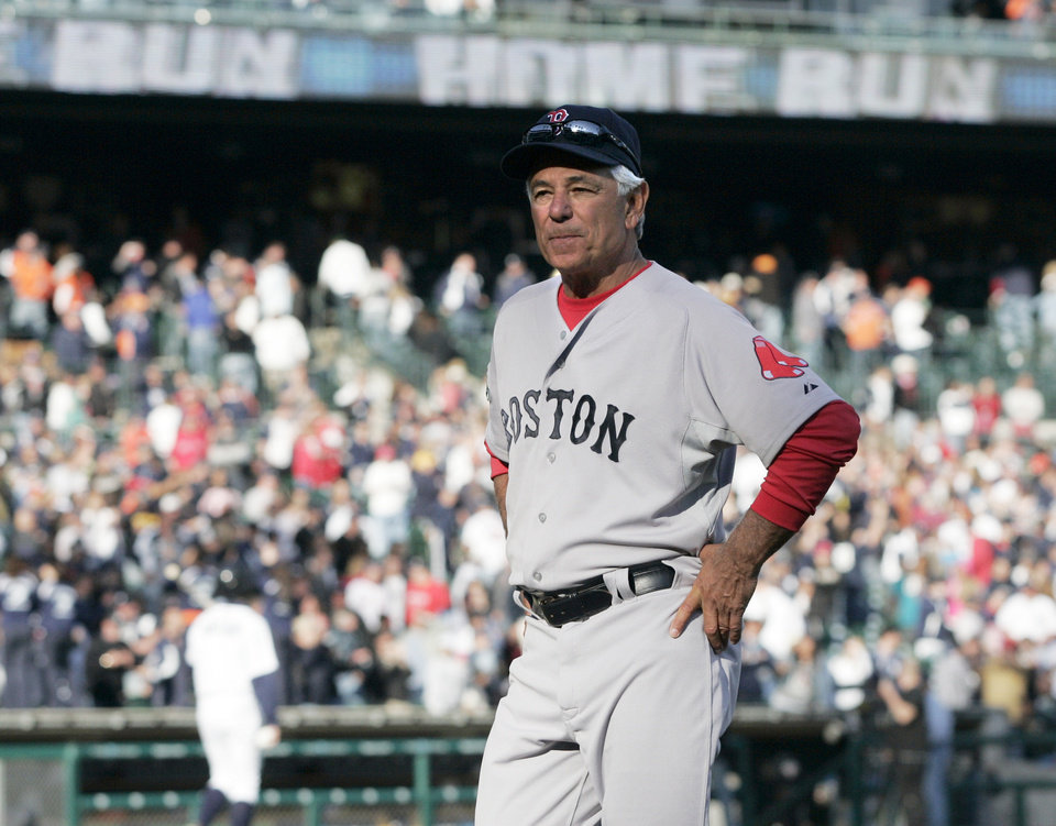 Photo -   Boston Red Sox manager Bobby Valentine walks off the field after the Detroit Tigers' 13-12 win on Alex Avila's two-run home run in the 11th inning of a baseball game Sunday, April 8, 2012, in Detroit. (AP Photo/Duane Burleson)