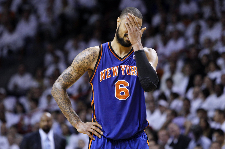 Photo -   New York Knicks' Tyson Chandler (6) reacts after being called for a technical foul in the first half of an NBA basketball game against the Miami Heat in the first round of the Eastern Conference playoffs in Miami, Monday, April 30, 2012. (AP Photo/Lynne Sladky)