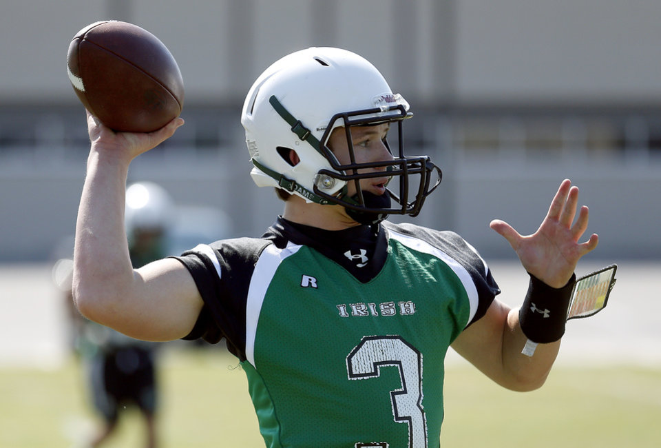 Photo - Jennings Jarman throws the ball during football practice at Bishop McGuinness High School in Oklahoma City, Okla.,  Tuesday, Aug. 12, 2014. Photo by Sarah Phipps, The Oklahoman