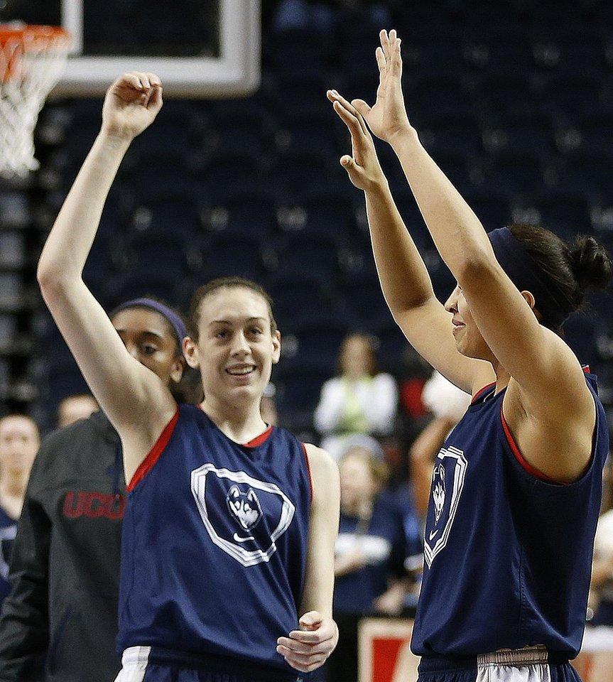 Photo - Connecticut forward Breanna Stewart, left, waves to fans during practice before the women's Final Four of the NCAA college basketball tournament, Saturday, April 5, 2014, in Nashville, Tenn. Connecticut plays Stanford Sunday. (AP Photo/Mark Humphrey)