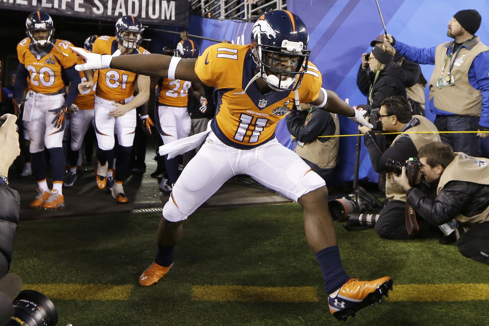 Photo - Denver Broncos' Trindon Holliday spreads his arms as runs on the field before the NFL Super Bowl XLVIII football game against the Seattle Seahawks on Sunday, Feb. 2, 2014, in East Rutherford, N.J. (AP Photo/Mark Humphrey)