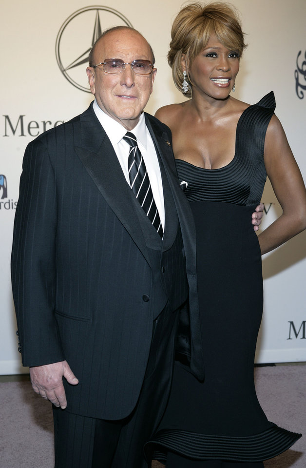 FILE - In this Oct. 28, 2006 file photo, Whitney Houston, right, and music producer Clive Davis arrive at the 17th Carousel of Hope Ball benefiting the Barbara Davis Center for Childhood Diabetes in Beverly Hills, Calif. Whitney Houston, who reigned as pop music's queen until her majestic voice and regal image were ravaged by drug use, has died, Saturday, Feb. 11, 2012. She was 48. (AP Photo/Matt Sayles, File) ORG XMIT: NY130