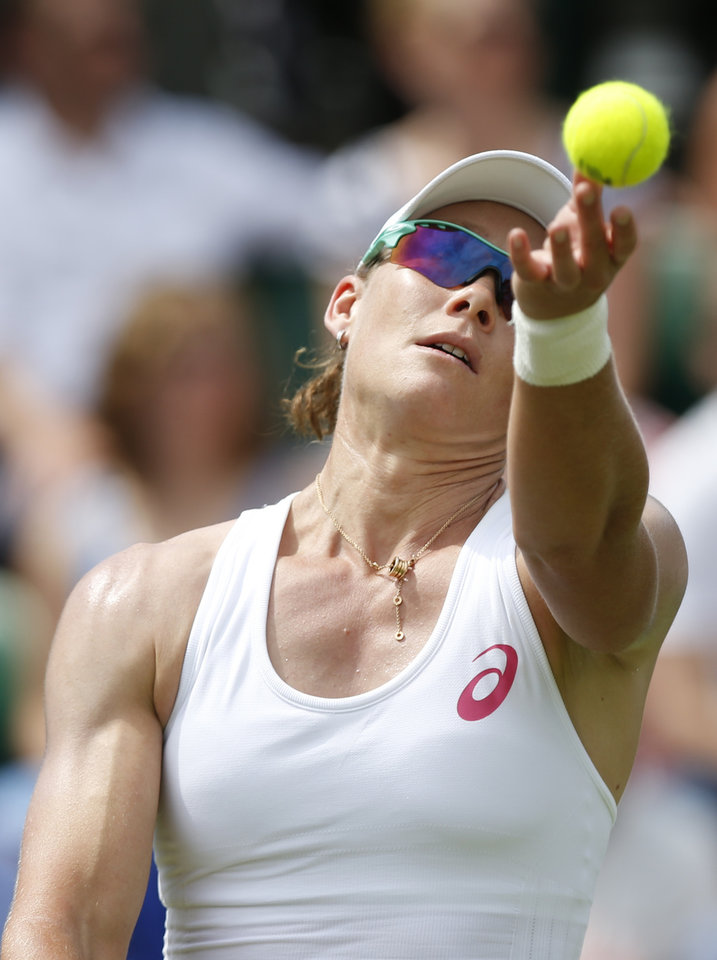 Photo - Australia's Samantha Stosur serves to Belgium's Yanina Wickmayer during their first round match at the All England Lawn Tennis Championships in Wimbledon, London,  Monday, June  23, 2014. (AP Photo/Sang Tan)