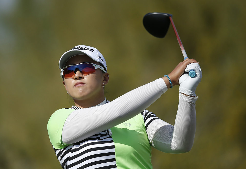 Photo - Amy Yang, of South Korea, watches her tee shot at the 9th hole during the final round of the LPGA Founders Cup golf tournament on Sunday, March 23, 2014, in Phoenix. (AP Photo/Ross D. Franklin)