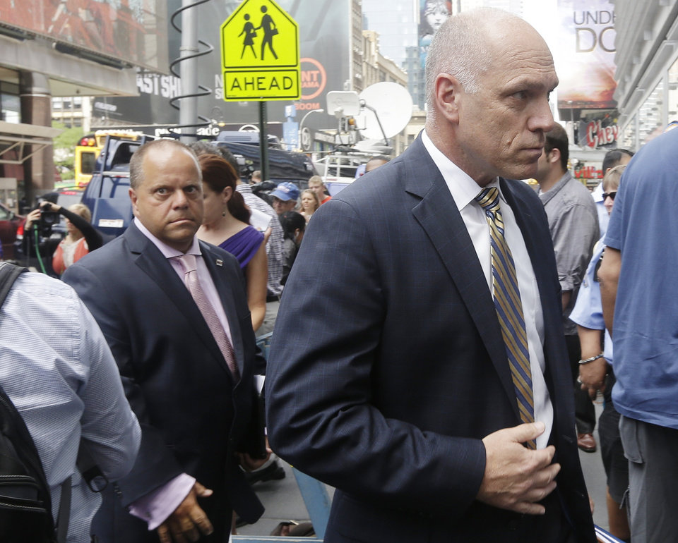 Photo - Anthony Simon, right, lead union negotiator for Long Island Rail Road Union, and union representative Dean Devita, approach the location for negotiations between the unions for Long Island Rail Road and the Metropolitan Transportation Authority in New York on Wednesday, July 16, 2014. Shortly after Gov. Andrew Cuomo issued an appeal Wednesday for the sides to resume talking, the Metropolitan Transportation Authority, which operates the Long Island Rail Road, invited union negotiators to resume talks and union officials accepted. (AP Photo/Frank Franklin II)
