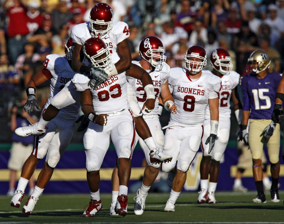 Photo - The Sooner defense celebrates after a Gerald McCoy (93) sack during the first half of the college football game between the University of Oklahoma Sooners (OU) and the University of Washington Huskies (UW) at Husky Stadium on Saturday, Sep. 13, 2008, in Seattle, Wash. 